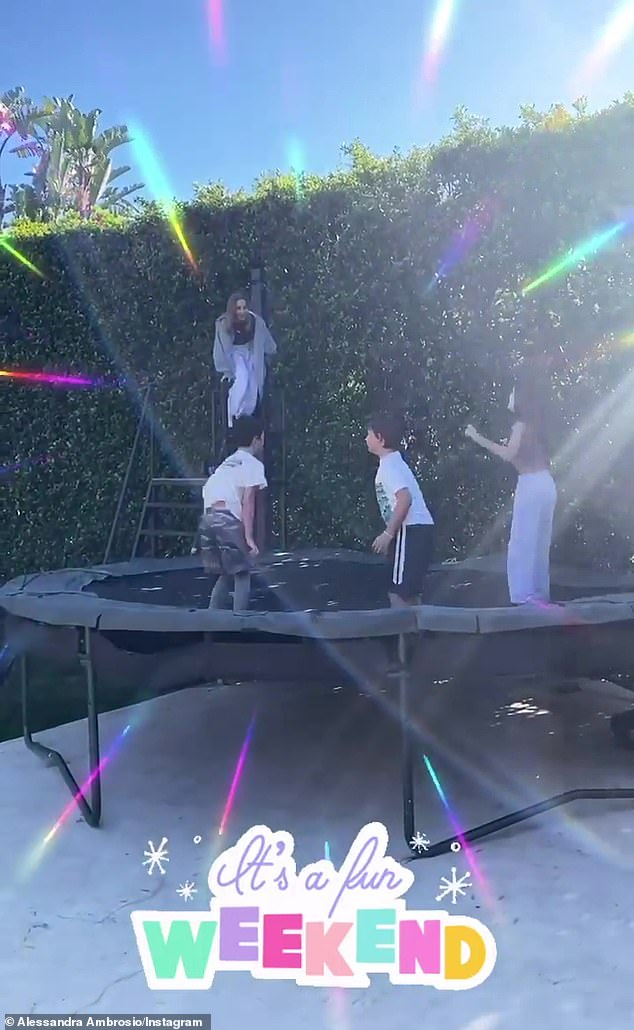 Playtime: The former Victoria's Secret angel said: 'It's a fun weekend' in a music video of her daughter Anja, 12, and son Noach, eight, jumping on a trampoline with two friends