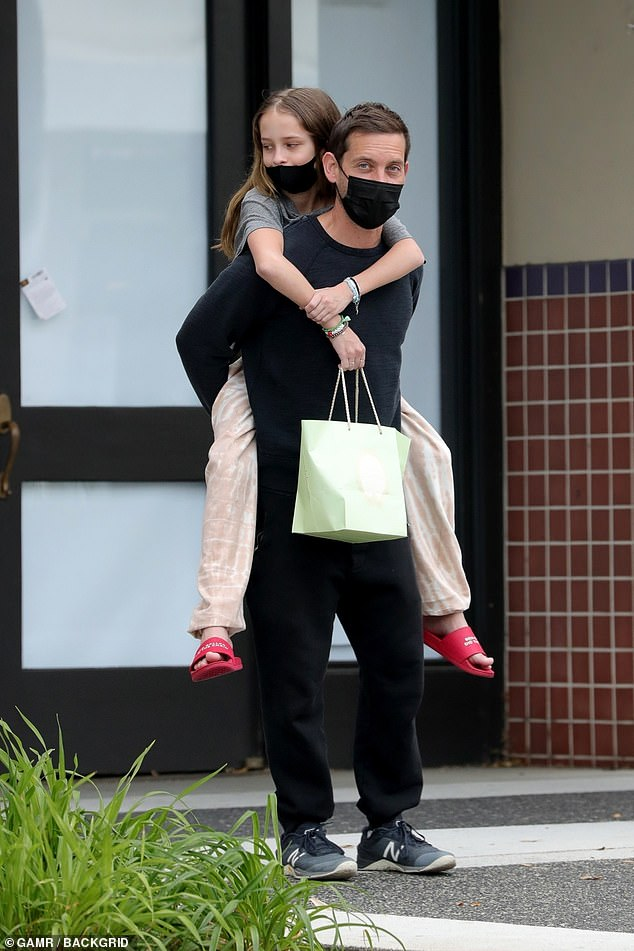 Piggyback: Tobey Maguire gave his 14-year-old daughter Ruby a piggyback after shopping