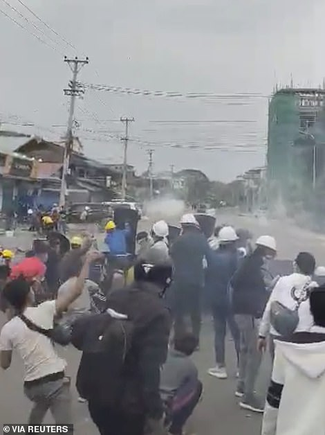 People clash with police during a protest in Myitkyina, Myanmar