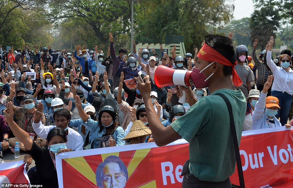Protesters hold up three finger salute during a demonstration against the military coup in Naypyidaw on March 8