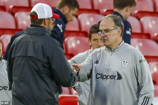 Marcelo Bielsa (right) may have to ward off interest from Liverpool boss Jurgen Klopp (left)