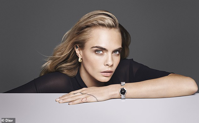 Graceful: The photogenic model, 28, worked her best angles by delicately presenting jewelry and timepieces from the Gem Dior collection