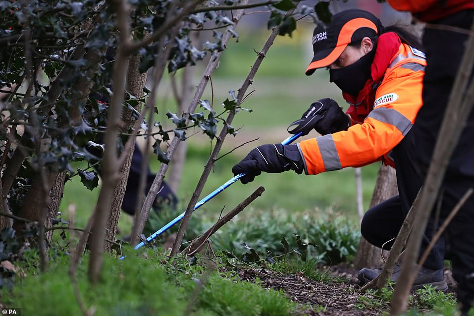 Pictured: A team seen searching undergrowth yesterday. She is thought to have left Leathwaite Road through a back gate