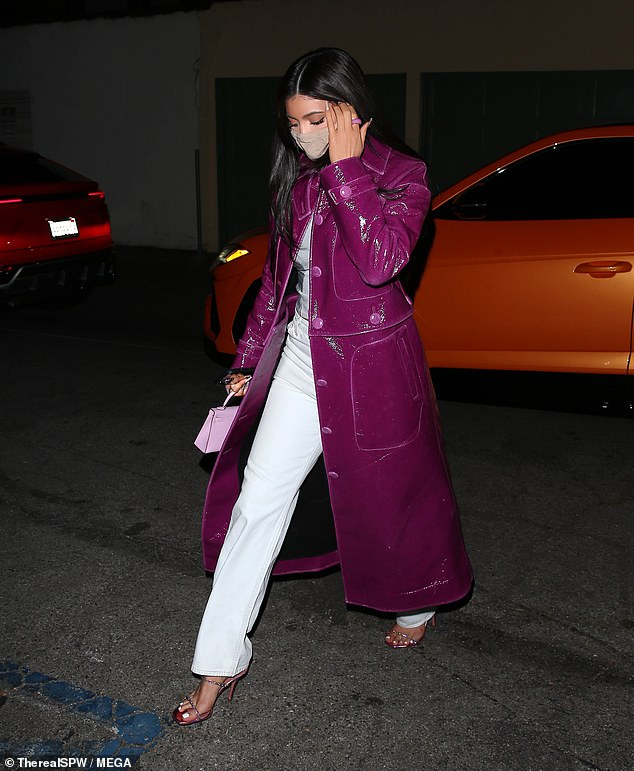 Simply Stylish: Kylie Jenner looked as stylish as ever as she donned a shiny magenta-colored trench coat as she walked to Craig's in West Hollywood on Saturday night.