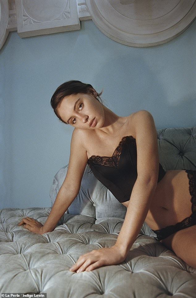 Stunning: The model, 20, put on a sultry display as she slipped into a black corset trimmed with beautiful Jacquard lace