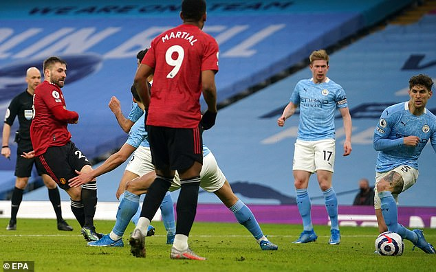 Luke Shaw (left) capped a brilliant performance against Manchester City with this goal