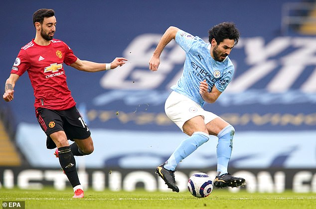 Ilkay Gundogan on the ball during Manchester City's loss to rivals United in Sunday's derby