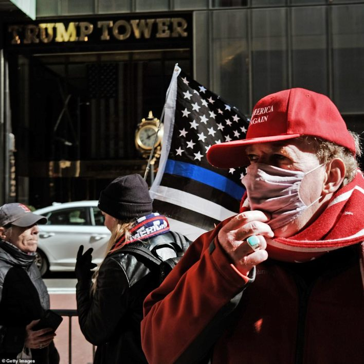 A small group of supporters of former president Donald Trump held a rally in front of Trump Tower on Monday