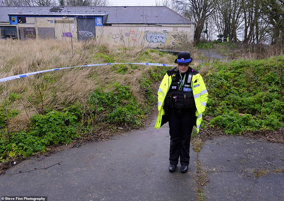 A now-derelict garage where Couzens worked at his family mechanics business was taped off by investigating police today