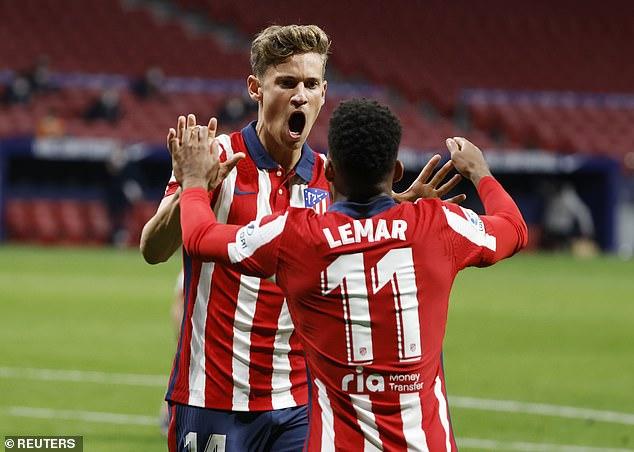 Llorente celebrates scoring Atletico's opening goal with team-mate Thomas Lemar