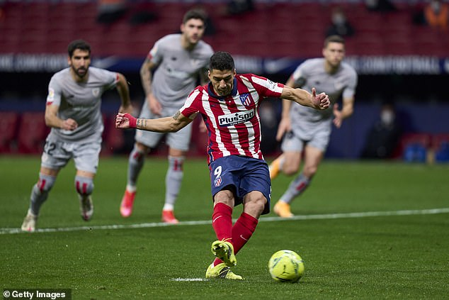 Atletico Madrid striker Luis Suarez scores from the penalty spot to put his side ahead