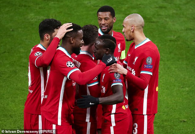 Reds stars surround Sadio Mane (front centre) who netted four minutes after Salah's opener