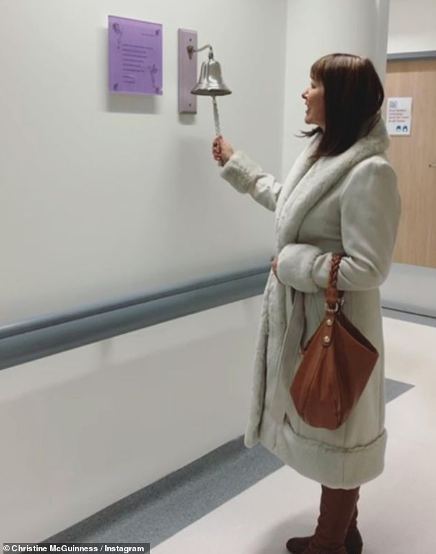 Milestone moment:The lingerie model, 32, took to Instagram to post a photo of her mum ringing the bell to signal the end of her treatment