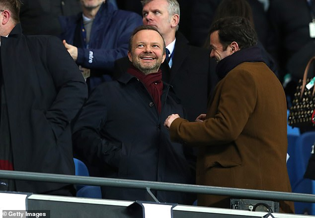 Instead, he opted to stay and was rewarded for his loyalty by his boss Ed Woodward (centre)