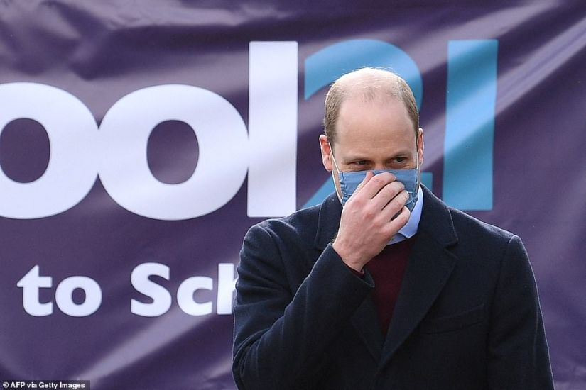 The Duke of Cambridge adjusts his mask during a visit to School21, where the couple were discussing the mental health resources on offer