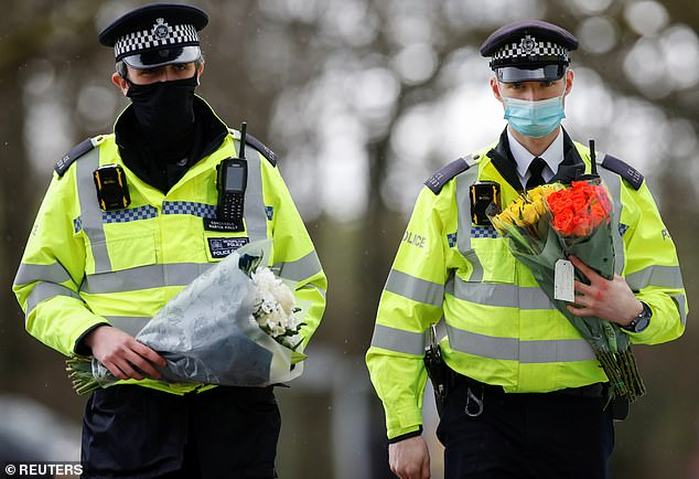 Officers from the Metropolitan Police laid flowers at the gates of the disused golf course and sports centre close to the woodland where remains were found