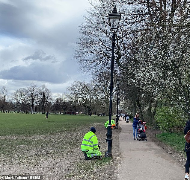 Street lighting was being fixed on Clapham Common in London this morning