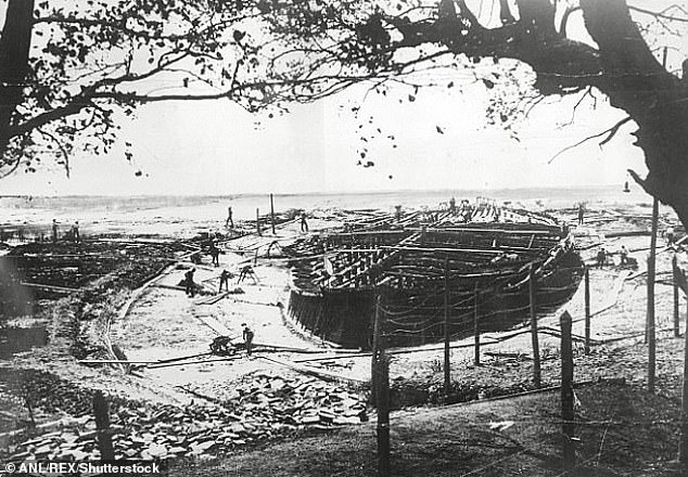It is suspected that retreating Nazi forces torched the museum out of spite as the Allied forces pushed into Italy. The mosaic, which had been moved to Rome, was spared damage in the resulting inferno. Pictured: one of the two vast Nemi ships being excavated from the lake