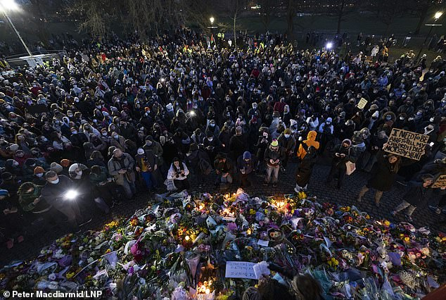 Hundreds of mourners defied social distancing to gather at Clapham Common to remember the murdered marketing executive