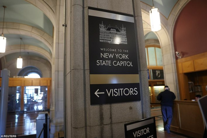 Anger has reportedly flared among staffers after Cuomo, 63, blasted the demands for him to quit on Friday as 'cancel culture', as they accuse him of being a 'fake tough guy'. Pictured: the near empty State Capitol on Friday