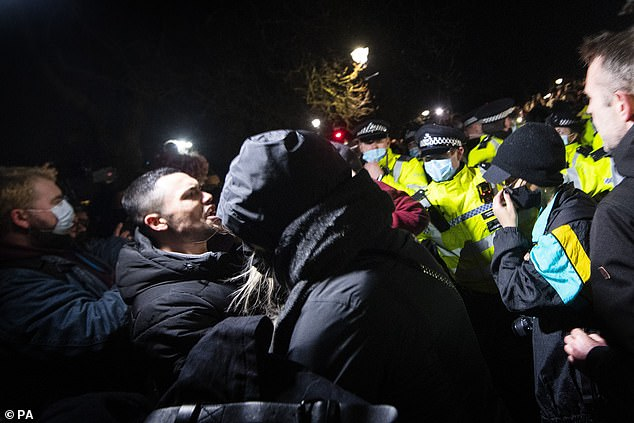 In the early hours of Sunday, Assistant Commissioner Helen Ball said police were put into a position 'where enforcement action was necessary'. Pictured: Police and demonstrators clash at the scene