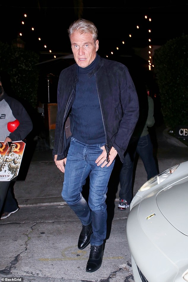 Out and about: Dolph Lundgren hit the town for a romantic night out with his lady love in Los Angeles on Saturday night