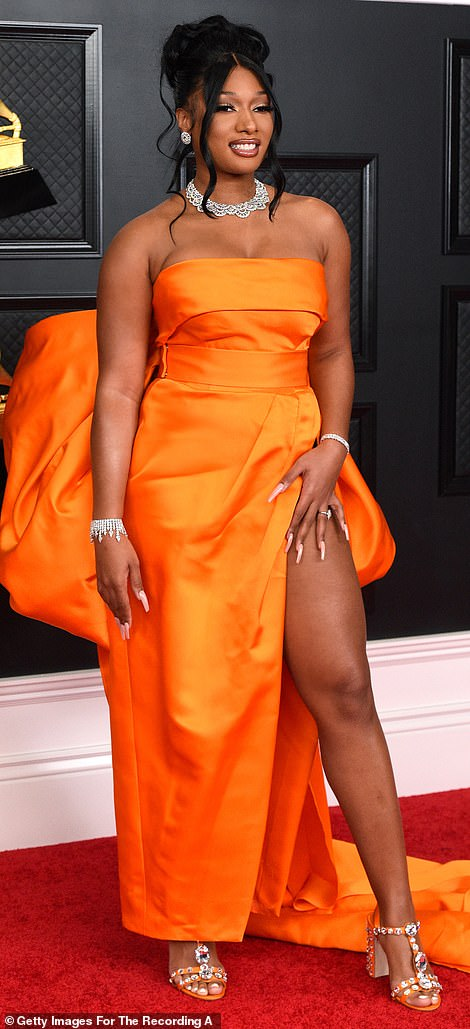 Bring the glam: The rap star showed off some leg with a sexy thigh high slit and wore her hair in an elegant updo
