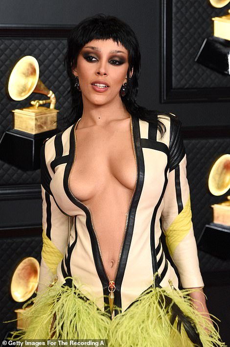 Jaw-dropping: The dress flaunted extreme cleavage and the Say So hitmaker added even more drama with a super smokey eye and jet black wig