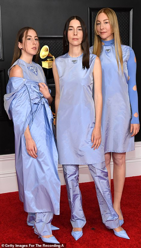 Group love: The Haim sisters matched in lavender outfits while Anderson .Paak and Bruno Mars of Silksonic wore jazzy suits and sunglasses