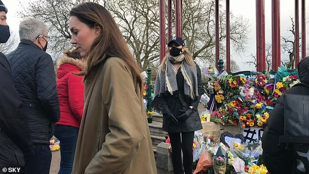 The Duchess of Cambridge (pictured) was one of the women who paid a private visit to the makeshift shrine. She was seen pausing in front of floral tributes before laying two bunches of daffodils