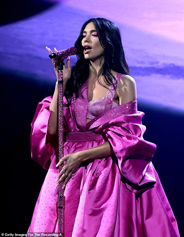 Incredible: She also slipped into a bright pink gown for her time on the stage