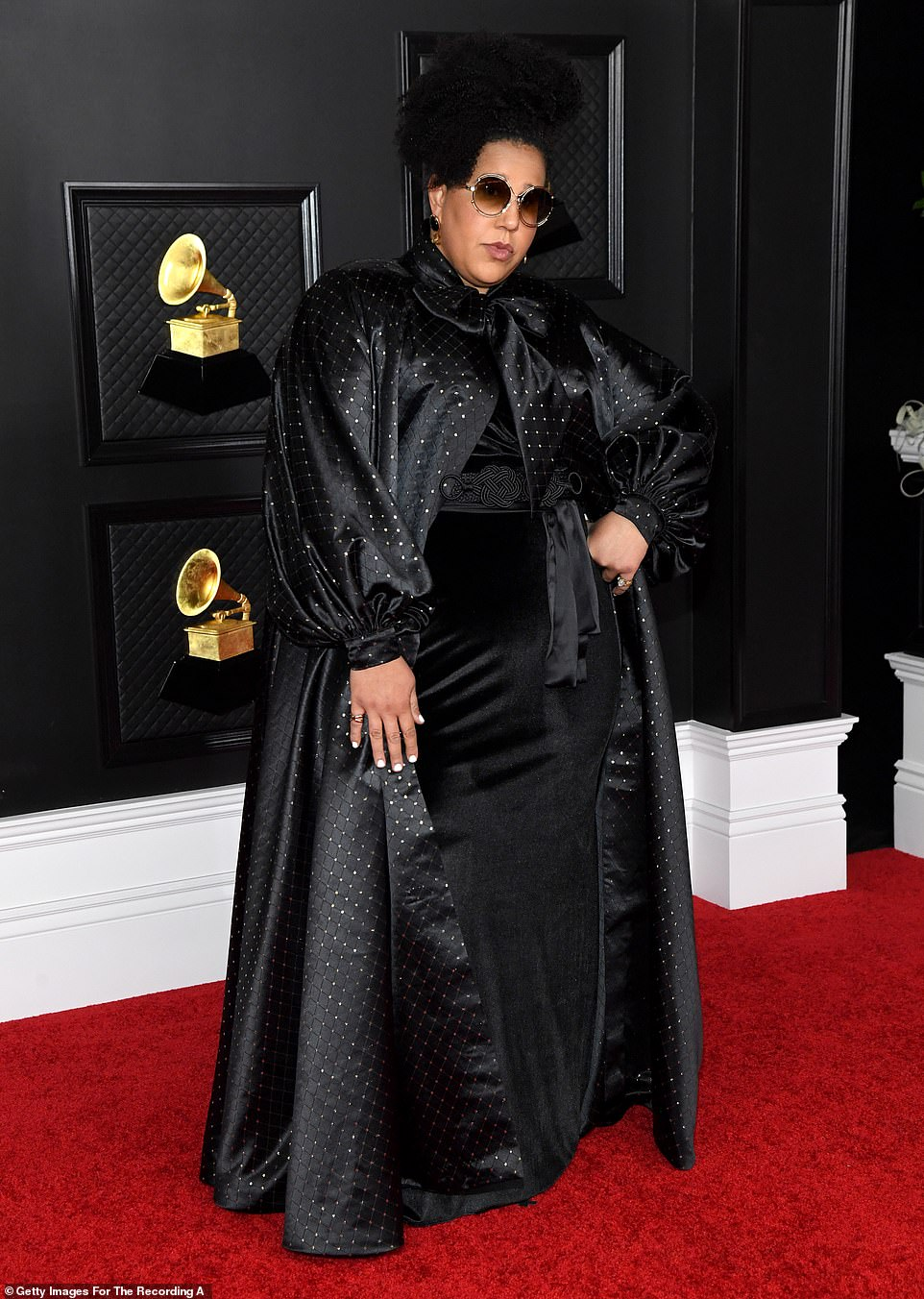 Dark side: Brittany Howard opted for gothic glam in a black gown and dramatic cape with silver sequins