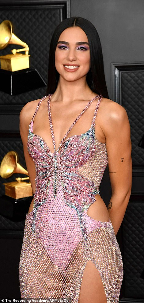 'This dress was made for me by Versace,' the singer told People on the carpet. 'I love it. I feel, I feel like a princess in it so yeah I'm thrilled.'
