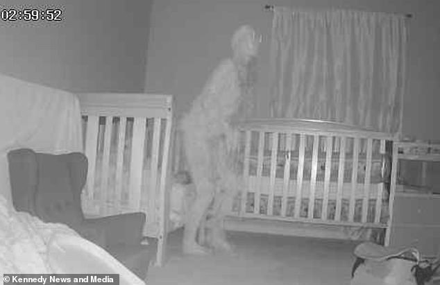 A grandmother has captured a terrifying image of a 'horned demon' standing over her grandchild's bed in the middle of the night. She caught the creature on video after son said two-year-old Amber had been speaking in the night
