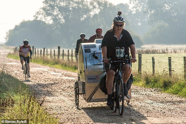 Riding shotgun: Friends and family accompany Simon on the route to the English Channel