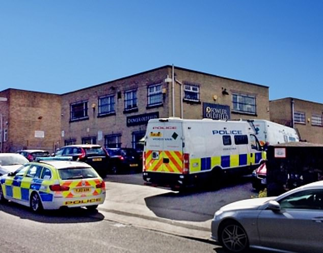 Swoop: Police raid the gold dealer Fowler Oldfield's Bradford premises in September 2016 where couriers would drop off bags stuffed with cash totalling up to £2m a day