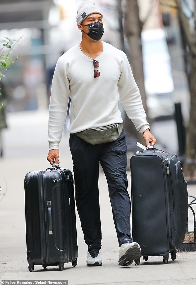 Travel time: The Bachelorette reality stars seemed to be ready to travel as Dale wheeled around suitcases while masked up after the couple reconciled following the end of their engagement earlier this year