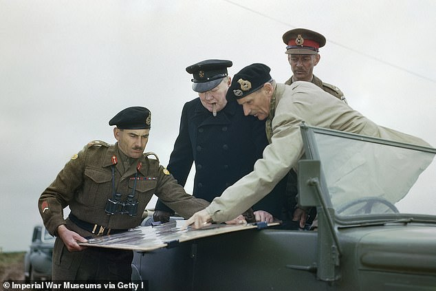 Then Prime Minister Winston Churchill visits Caen, Normandy, 22 July 1944, as General Sir Bernard Montgomery indicates positions on a map held by the Commander of the 2nd Canadian Division, General G G Symonds
