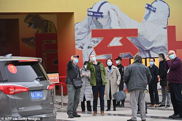 Members of the WHO's expert panel arrive to visit a museum exhibition about China's fight against Covid-19, on a visit in January which raised doubts about China's transparency