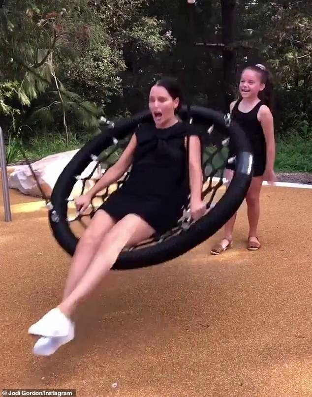 Role reversal! Jodi Gordon put her seven-year-old daughter Aleeia to work when they enjoyed a day at the park on Thursday