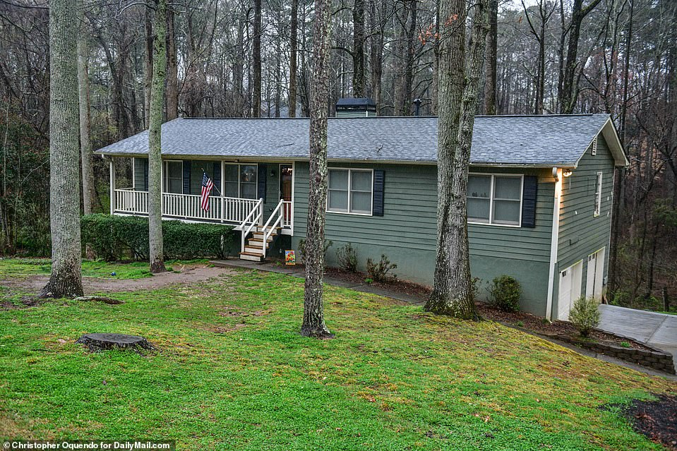 Pictured is Long's home in Woodstock, Georgia.u00A0Officers say they found Robert Aaron Long, 21, thanks to help from his parents, who recognized him from surveillance footage posted by authorities and gave investigators his cellphone information. Cherokee County sheriff Frank Reynolds said cops then used that information to track and find him, adding: 'Theyu2019re very distraught, and they were very helpful in this apprehension'