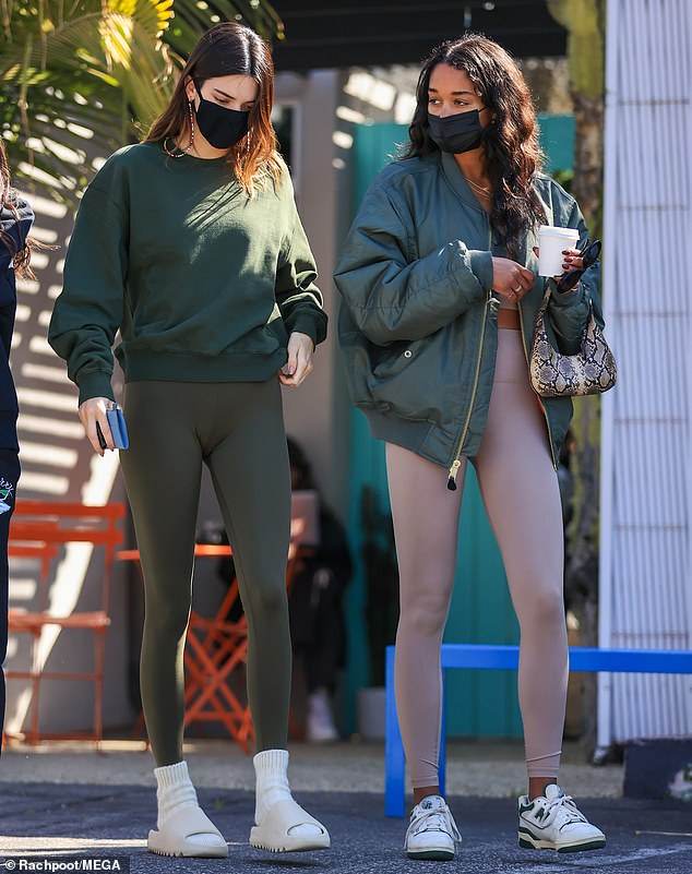 Chilling out: On Friday, Kendall Jenner was spotted grabbing coffee with a group of her friends one day after she returned to Los Angeles after finishing a trip to an undisclosed location
