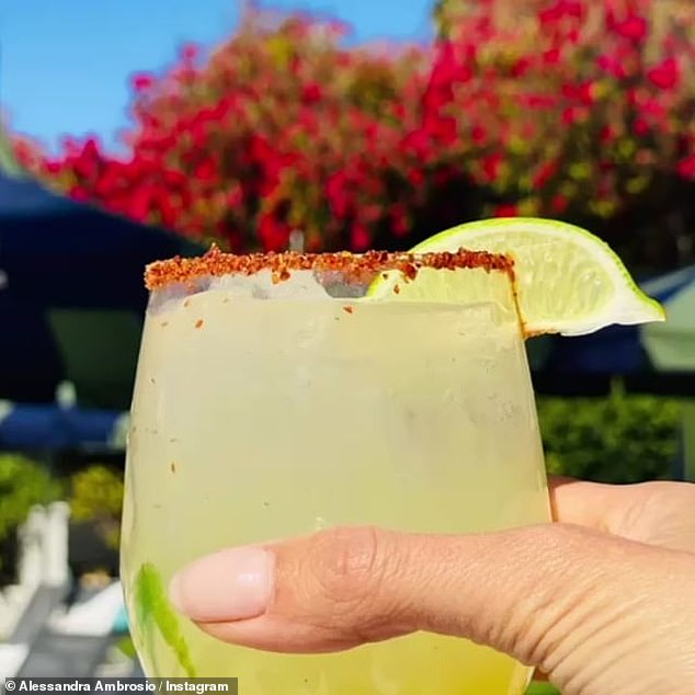 Feeling festive: The longtime Victoria's Secret Angel enjoyed a margarita while at the pool