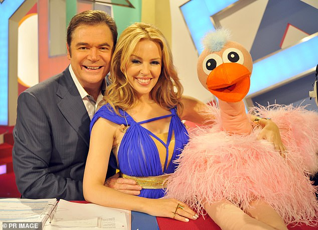 He added:u00A0'I can't say I am enamoured with it, but it is a changing world in which we live and you just have to work around things,' he said. Pictured on Hey Hey with Kylie Minogue in 2010