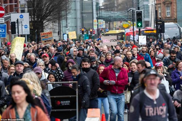 Hundreds of anti-lockdown protesters march through Manchester City Centre to Greater Manchester Police HQ to hand in crime reports