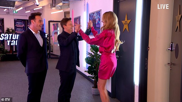 Greeting: Cat wore a hot pink silk dress as she appeared on the show, clasping Dec's hand upon arrival