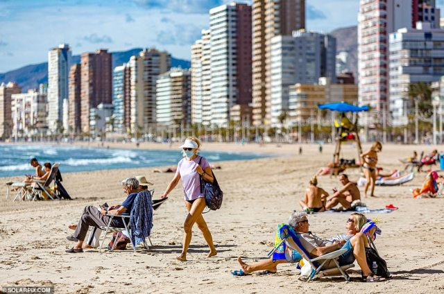 A government scientist has warned foreign trips are 'extremely unlikely' this summer as Europe struggles to control a surge in coronavirus cases. Pictured: Benidorm today