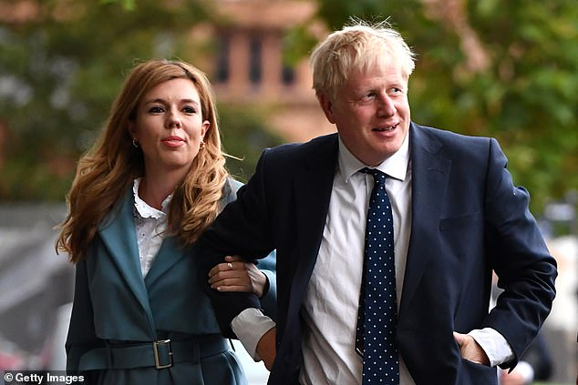 Pictured: Carrie Symonds and Boris Johnson at the Conservative Party Conference in 2019
