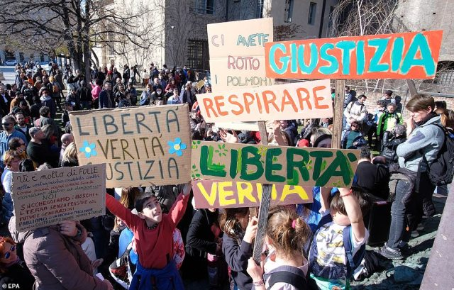 ITALY: In Turin, Italy, demonstrators attend an anti-lockdown protest holding signs that say 'freedom' and 'truth'