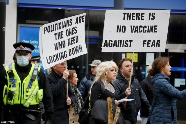 Protesters also took to the streets of Manchester and marched to the Police Headquarters after branding the lockdown a 'crime against humanity' today